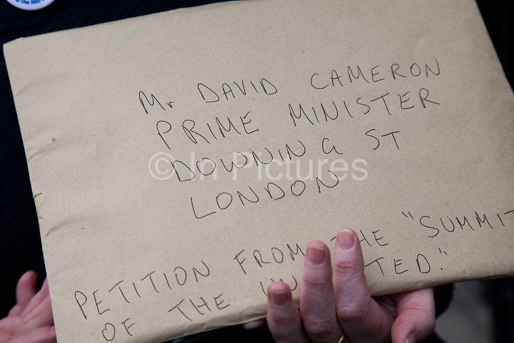 A petition for the Prime Minister signed by hundrerds of people is delivered to Downing street. Protesters gathered outside on Whitehall in a demonstration called 'Summit of the Uninvited', Downing Street, London, UK. Outside the Prime Minister's summit meeting where he invited selected health professionals and private companies to discuss implementation of the health bill and the future of the NHS and excluded all the organisations critical of the bill. <br /> <br /> It has been alleged this shows the government's desperation that they have had to rapidly convene this meeting to try to cobble this together at the last minute to try to show they still have some professional support and to split the profession and marginalise those who are critical.