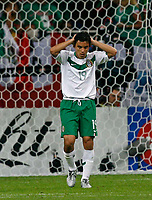Photo: Glyn Thomas.<br />Portugal v Mexico. FIFA World Cup 2006. 21/06/2006.<br /> Mexico's Omar Bravo with his head in his hands after missing his penalty attempt.