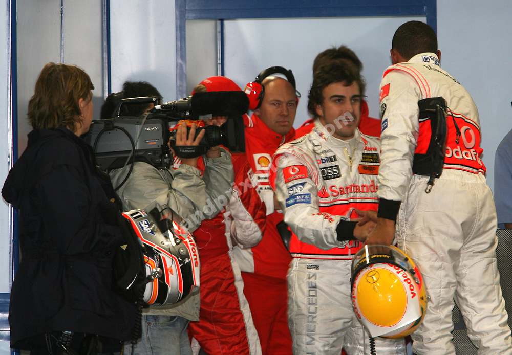 McLaren-Mercedes drivers Fernando Alonso and Lewis Hamiltonm shake hands after qualifying for the 2007 Japanese Grand Prix at Fuji. Photo: Grand Prix Photo