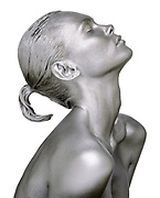 Profile of nude woman's head, face and shoulders covered in silver paint