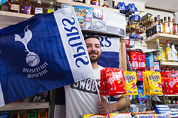 Shopkeeper and dedicated Spurs fan Gokhan Hayirili waves the flag for his club at Park Lane Mini Market opposite Spurs' New stadium ahead of Tottenham's Champions League final with Liverpool to be played at Atletico Madrid's Wanda Metropolitano Stadium in Madrid. Tottenham, London, May 29 2019.
