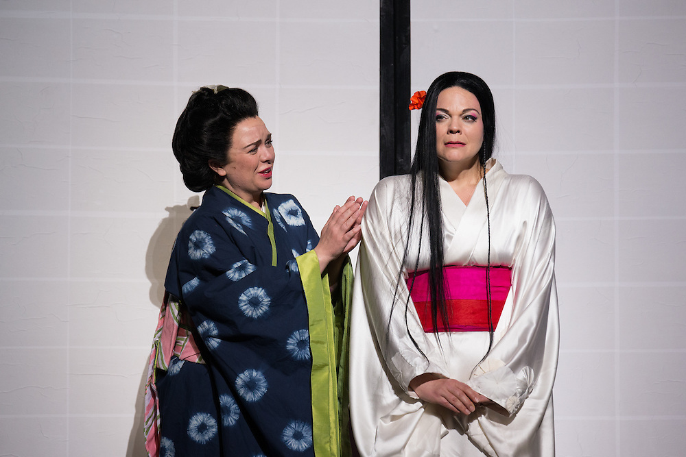 """LONDON, UK, 14 May, 2016. Stephanie Windsor-Lewis (left, as Suzuki) and Rina Harms (right, as Butterfly) rehearse for the revival of director Anthony Minghella's production of Puccini's opera """"Madam Butterfly"""" at the London Coliseum for the English National Opera. The production opens on 16 May. Photo credit: Scott Rylander."""