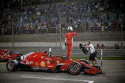 April 7, 2018 - Sakhir, Kingdom of Bahrain - SEBASTIAN VETTEL of Scuderia Ferrari celebrates pole position after the 2018 FIA Formula 1 Bahrain Grand Prix qualifying session at Bahrain International Circuit in Sakhir, Kingdom of Bahrain. (Credit Image: © James Gasperotti via ZUMA Wire)