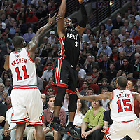 14 March 2012: Miami Heat shooting guard Dwyane Wade (3) takes a three point jumpshot during the Chicago Bulls 106-102 victory over the Miami Heat at the United Center, Chicago, Illinois, USA.