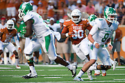 AUSTIN, TX - AUGUST 30:  Malcom Brown #90 of the Texas Longhorns chases the ball against the North Texas Mean Green on August 30, 2014 at Darrell K Royal-Texas Memorial Stadium in Austin, Texas.  (Photo by Cooper Neill/Getty Images) *** Local Caption *** Malcom Brown