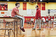 ORADELL, NJ - October 3: The players are designated to get ready in their gymnasium where all classes are also held.<br /> <br /> Coach Vito and QB Steve Angeli share a moment before they head to the bus for their first game.<br /> <br /> We are in the midst of witnessing something this world has never experienced - a global pandemic. The coronavirus has swept away the world in March of 2020 - since then, the world we know It hasn't been the same. Jobs, businesses and futures have been put on hold and lost, yet, we have to power through to overcome one of the greatest obstacles this we have faced. The high school football season wasn't suppose to happen, but a glimmer of hope, intense safety measures & a little bit of luck has allowed for the season to start, now the question is ' Can It be completed?'<br /> <br /> Photo by Johnnie Izquierdo