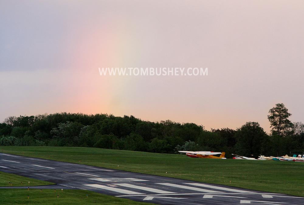 Wawayanda, New York - A rainbow fades in the sky behind Randall Airport on May 8, 2010.