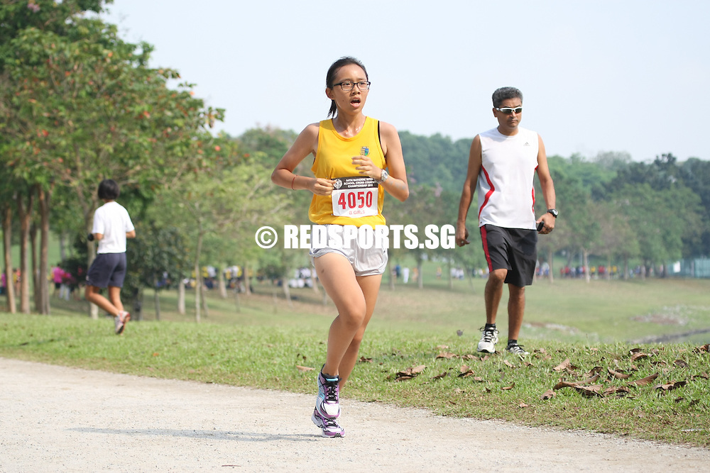 Bedok Reservoir Park, Wednesday, March 27, 2013 — Kathleen Lin of Crescent Girls' School caused a major upset when she put in a last-minute charge, blazing past many favourites to clinch the B Division gold at the 54th National Schools Cross Country Championships. She completed the 3.6-kilometre route in a time of 14 minutes 32.87 seconds.<br /> <br /> Story: http://www.redsports.sg/2013/03/31/b-div-cross-country-girls-kathleen-lin-crescent-girls-cedar-girls/