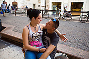 A couple become romantic on the street in Verona, Italy