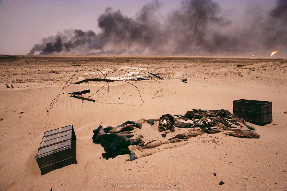 A dead Iraqi soldier surrounded by unexploded landmines in the Manageesh Oil Fields in Kuwait near the Saudi border. Huge amounts of munitions were abandoned in Kuwait by retreating Iraqi troops in February 1991. Also, nearly a million land mines were deployed on the beaches and along the Saudi and Iraqi border. In addition, tens of thousands of unexploded bomblets (from cluster bombs dropped by Allied aircraft) littered the desert. More than 700 wells were set ablaze by retreating Iraqi troops creating the largest man-made environmental disaster in history.