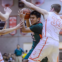 Wingate Bear Leon Alonzo (21) is fouled by the Artesia Bulldogs as he charges to the hoop Thursday at Gallup High School.