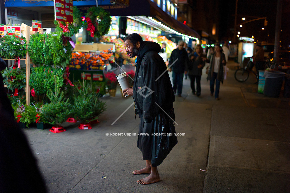 Jeffery Hillman is the barefoot homeless man who was photographed last week as a police officer give him a pair of boots outside the Skechers store on 42nd St in Times Square. The photo has gone viral on the internet praising the officer, but Jeffery still lives on the streets and claims to have hidden the boots out of fear he would be robbed if people saw him wearing them. He also presented the photographer a veterans ID card and claims to have two children in their early 20s. ..Photo by Robert Caplin..