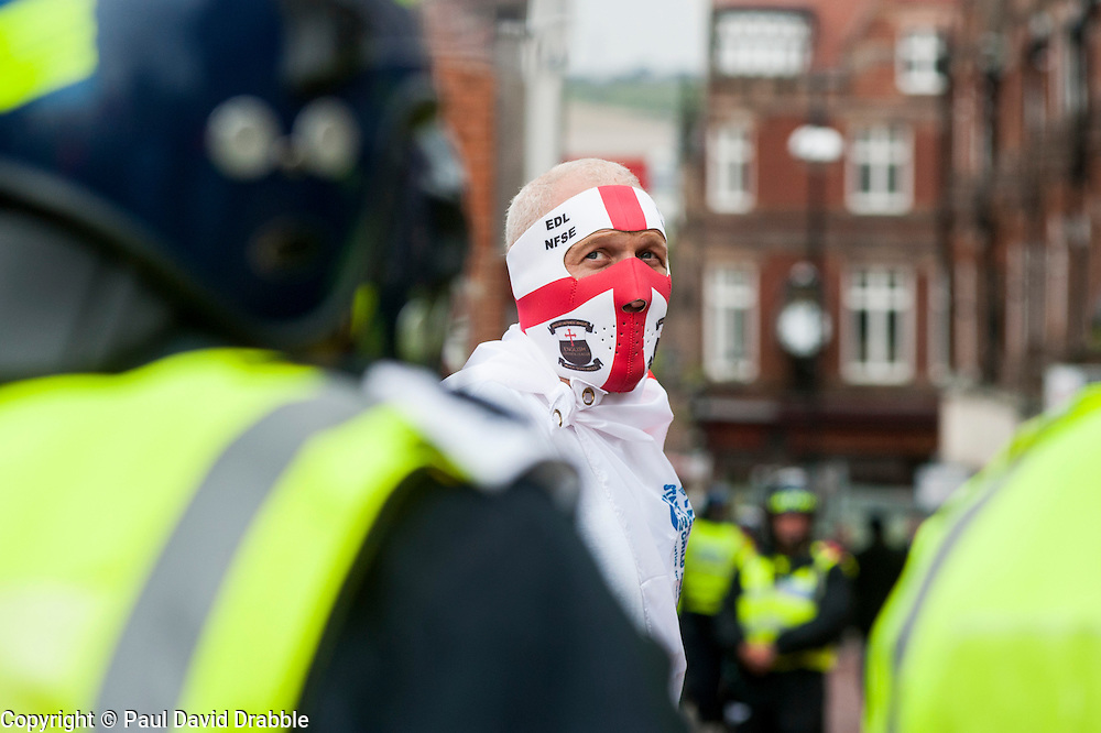"""Rotherham England<br /> 13 September 2014 <br /> an EDL supporter and Police in full Riot kit on the streets close to Rotherham Town Hall before the start of the English Defence Leagues Justice for the Rotherham 1400 March on Saturday Afternoon described by an EDL Facebook Page as """"a protest against the Pakistani Muslim grooming gangs"""" on Saturday Afternoon <br /> <br /> <br /> Image © Paul David Drabble <br /> www.pauldaviddrabble.co.uk"""