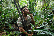 Ecuador, May 7 2010: Ninke Re demonstrates how to produce a toucan's call using a rolled leaf. Copyright 2010 Peter Horrell