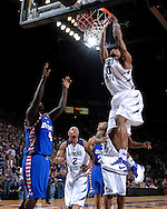 Kansas State forward Cartier Martin (20) dunks the ball over DePaul defender Wesley Green (4), during second half action at Bramlage Coliseum in Manhattan, Kansas, March 19, 2007.  DePaul defeated Kansas State in the second round of the NIT 70-65.