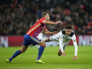 Tottenham's Dele Alli goes down under the challenge of CSKA Moscow's Vasili Berezutski during the Champions League group match at Wembley Stadium, London. Picture date December 7th, 2016 Pic David Klein/Sportimage