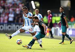 Cedric Soares of Southampton clears under pressure from Tom Ince of Huddersfield Town - Mandatory by-line: Matt McNulty/JMP - 26/08/2017 - FOOTBALL - The John Smith's Stadium - Huddersfield, England - Huddersfield Town v Southampton - Premier League