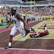 ORLANDO, FL - JANUARY 01: Bud Sasser #21 of the Missouri Tigers  catches a touchdown pass during the Buffalo Wild Wings Citrus Bowl against the Minnesota Golden Gophers at the Florida Citrus Bowl on January 1, 2015 in Orlando, Florida. (Photo by Alex Menendez/Getty Images) *** Local Caption *** Bud Sasser