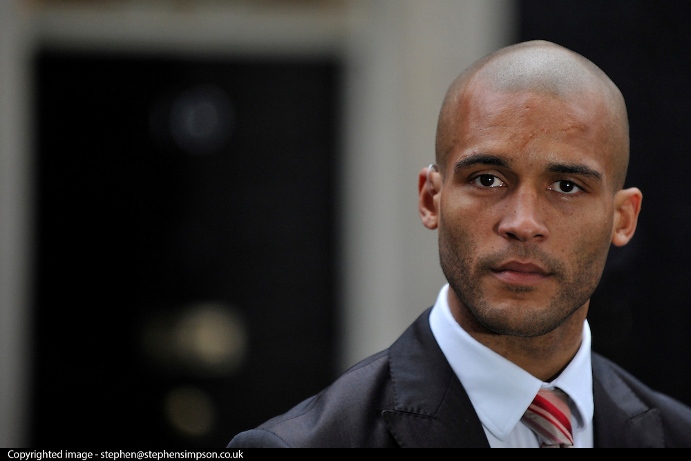 © Licensed to London News Pictures. 22/02/2012, London, UK. Footballer Clarke CarlisleBritish Prime in Downing Street. Minister David Cameron holds an anti-discrimination summit with former players and football bosses at Downing Street, central London. Photo credit : Stephen Simpson/LNP
