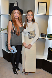 Left to right, LINDSAY LOHAN and ANNA LAUB founder of Prism at the Prism Boutique Summer Party held at Prism, 54 Chiltern Street, London on 14th May 2014.