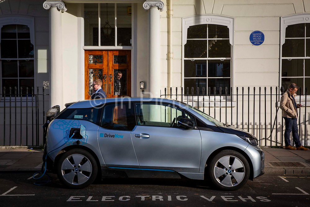 A BMW i3 electric car charging in an electric vehicle bay on Cavendish Square, central London, United Kingdom. The POLAR charging Network has over 6,000 charging points across the United Kingdom.