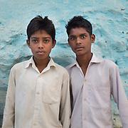 School students ready to leave for school, wearing uniform. Jabalpur.