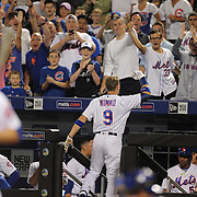 NEW YORK, NEW YORK - July 01:  Brandon Nimmo #9 of the New York Mets come out of the dugout for a curtain call  after hitting his first MLB home run, a three run homer in the fourth inning during the Chicago Cubs Vs New York Mets regular season MLB game at Citi Field on July 01, 2016 in New York City. (Photo by Tim Clayton/Corbis via Getty Images)