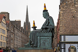 Edinburgh, Scotland, UK. 18 March 2020.Traffic cones placed on statue of David Hume on the Royal Mile in Edinburgh. Iain Masterton/Alamy Live News.