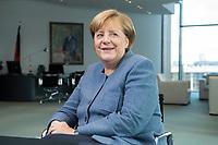 09 OCT 2017, BERLIN/GERMANY:<br /> Angela Merkel, CDU, Bundeskanzlerin, waehrend einem Interview, in ihrem Buero, Bundeskanzleramt<br /> IMAGE: 20171009-01-004<br /> KEYWORDS: Büro, freundlich, lacht, lachen