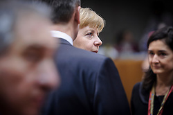 Angela Merkel, Germany's chancellor, center, speaks with colleagues during the first day of the EU Summit, at the European Council headquarters in Brussels, Belgium on Thursday, Dec. 13, 2012. (Photo © Jock Fistick)