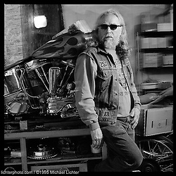 """Sloopy, Diablos MC. San Bernadino, CA. 1995<br /> <br /> Limited Edition Print from an edition of 50. Photo ©1995 Michael Lichter.<br /> <br /> The Story: An alternate lifestyle swept Sloopy into a legendary club of outlaws. Although, his lifestyle was raucous, violent, drug ridden and outside the law, he had his father's stability. During the most notorious days of his outlaw youth he worked a steady job for 12 years. Despite the drugs, the dealing, and the death of his father, he remained a stalwart member of his ever changing club for 32 years, only leaving for two years during the mid eighties. """"They weren't listening or paying attention to the writing on the wall"""", Sloopy explained. Family ultimately saved him from the fate of many outlaw motorcyclists. His girl friend of 20 years and now his wife for half a decade, Rose, reined him in from the world of constant drug use before he self-destructed."""