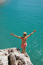 Boy cliff diving holiday ocean sunshine summer