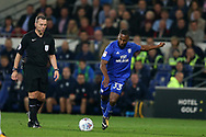 Junior Hoilett of Cardiff City in action as referee Kevin Friend looks on.. EFL Skybet championship match, Cardiff city v Leeds Utd at the Cardiff city stadium in Cardiff, South Wales on Tuesday 26th September 2017.<br /> pic by Andrew Orchard, Andrew Orchard sports photography.