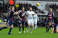 Swansea city's Michu © looks to go past Stoke's Ryan Shawcross (l). Barclays premier league, Swansea city v Stoke city at the Liberty Stadium in Swansea on Saturday 19th Jan 2013. pic by Andrew Orchard, Andrew Orchard sports photography,