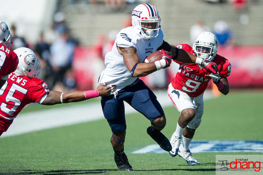 MOBILE, AL - OCTOBER 20:  Wide receiver Daniel McKinney #8 of the Florida Atlantic Owls attempts to maneuver around outside linebacker Clifton Crews #25 and cornerback Tyrell Pearson #9 of the South Alabama Jaguars on October 20, 2012 at Ladd-Peebles Stadium in Mobile, Alabama. At halftime Florida Atlantic leads South Alabama 17-14.  (Photo by Michael Chang/Getty Images) *** Local Caption *** Daniel McKinney;Clifton Crews;Tyrell Pearson