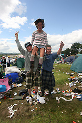 Clean-up pic on the Monday at the main camp site area with Steven Scott, Lisa McDonald and Bryan Conway, T in the Park, Monday 9 July 2007..T in the Park festival took place on the 6th, 7th and 8 July 2007, at Balado, near Kinross in Perth and Kinross, Scotland. This was the first time the festival had been held over three days..Pic ©Michael Schofield. All Rights Reserved..