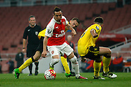 Santi Cazorla of Arsenal going past two Aston Villa defenders during the match. U21 Barclays Premier league play off final match, Arsenal U21's v Aston Villa U21's at the Emirates Stadium in London on Tuesday 10th May 2016.<br /> pic by Steffan Bowen, Andrew Orchard sports photography.