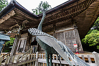 """Kakurinji Temple Crane- Kakurinji is the 20thtemple of the Shikoku Pigrimage and one of thenanshotemples, that is to say it is difficult to reach due to its location on a steep mountain. The main gate contains wooden sculptures of cranes, the temple's guardians. Kakurinji means """"crane forest temple"""" from the legend that when Kobo Daishi was climbing the moutain he came upon a pair of cranes protecting a tiny statue. Cranes are auspicious symbols in Japan sybolizing longetivity.  Because of its auspicious association withcranesthe temple received patronage over the centuries from emperors, shoguns and warlords. Kakurin-ji is the only temple on the pilgrimagethat has never been razed by fire"""