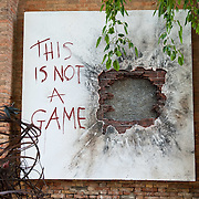 VENICE, ITALY - JUNE 04: 'This is not a game' an installation by Lorenzo Quinn, son of actor Anthony Quinn, in front of Isle of S. Servolo on June 4, 2011 in Venice, Italy. The Venice Art Biennale will run from June 4 to November 27, 2011.