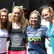 Tournament Director Anne Worcester (centre, right), takes the ALS Ice Bucket Challenge with the help of Tennis players Simona Halep, (left), Caroline Wozniack, (centre), and Petra Kvitova, (right), during the Connecticut Open at the Connecticut Tennis Center at Yale, New Haven, Connecticut, USA. 17th August 2014. Photo Tim Clayton
