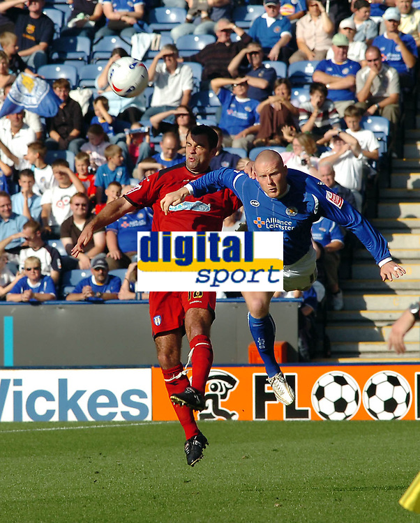 Photo: Kevin Poolman.<br />Leicester City v Colchester United. Coca Cola Championship. 23/09/2006. Chris Barker (Colchester) and Leicester's Josh Low go up for the ball.