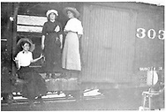 """Box car #303? With 3 women in the door.<br /> D&RG    ca 1912<br /> In book """"Durango: Always a Railroad Town (1st ed.)"""" page 75"""