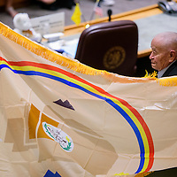 John Pinto presents a Navajo Nation flag for Gallup McKinley County Day at the New Mexico State Capital Building in Santa Fe Thursday.