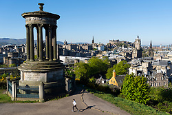 Edinburgh, Scotland, UK. 6 May 2020.  Unbroken sunshine and windless weather proved beautiful conditions for a female jogger taking daily exercise during the covid-19 lockdown on Calton Hill in Edinburgh today. The famous tourist destination was virtually deserted with only local joggers and dog walkers out enjoying the sunshine.  Iain Masterton/Alamy Live News
