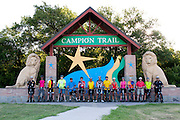"""Participants of the first  """"Elected Officials bike ride"""" pose for a photo along the Champion Trail in Irving, Texas on August 6, 2013. Riders included nearly 15 mayors and council members from around north Texas with the aim to promote biking in their neighborhoods. (Cooper Neill / Texas Tribune)"""