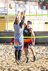 © Licensed to London News Pictures. 18/01/2020. Brighton, UK. Members of the Brighton Beach Volleyball Club take advantage of the sunny and milder weather to play a few games in Brighton and Hove. Photo credit: Hugo Michiels/LNP