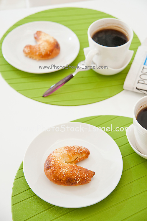 Freshly baked croissants, espresso and newspaper for breakfast