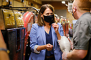 14 JULY 2020 - ADEL, IOWA: THERESA GREENFIELD, left, talks to BRIAN SMITH, right, about bowling pins at the Adel Family Fun Center, a bowling alley Smith owns in Adel, IA, about 25 miles west of Des Moines. Theresa Greenfield, a Democrat, is running for the US Senate against incumbent Senator Joni Ernst. Recent polls have Greenfield slightly ahead of or statistically tied with Ernst, who is closely allied with President Donald Trump. This was one of Greenfield's first live campaign events since the Coronavirus pandemic shutdown started in March. She has been campaigning virtually using teleconferencing apps.      PHOTO BY JACK KURTZ