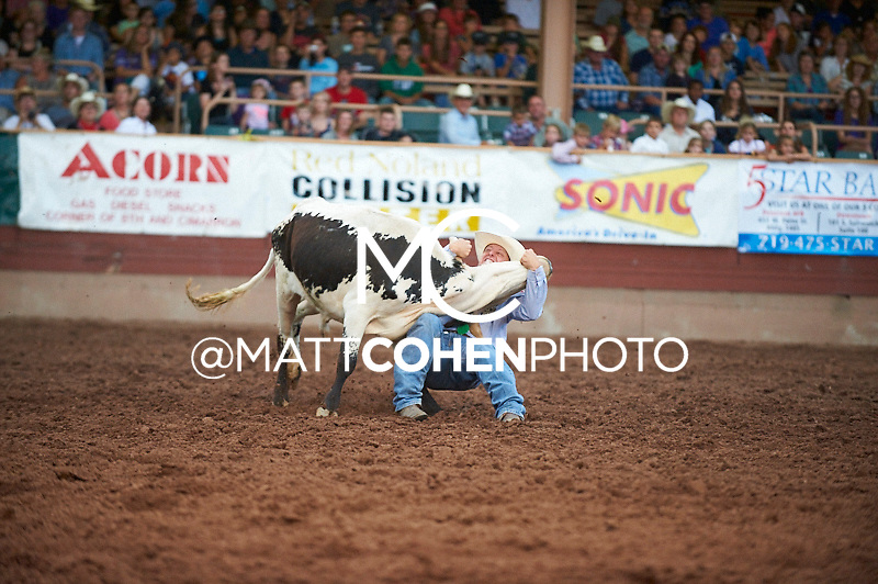Steer wrestler Chad Van Campen of Grenada, CO competes at the Pikes Peak or Bust Rodeo in Colorado Springs, CO.<br /> <br /> <br /> UNEDITED LOW-RES PREVIEW<br /> <br /> <br /> File shown may be an unedited low resolution version used as a proof only. All prints are 100% guaranteed for quality. Sizes 8x10+ come with a version for personal social media. I am currently not selling downloads for commercial/brand use.
