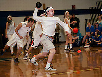 Brandon Sasserson of the White Out Sophomore team in a game of dodge ball at Gilford High School's Winter Carnival on Friday afternoon.  (Karen Bobotas/for the Laconia Daily Sun)
